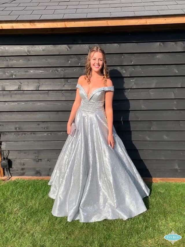 Girl Wearing Silver Sparkle Prom Dress With Bardot Line