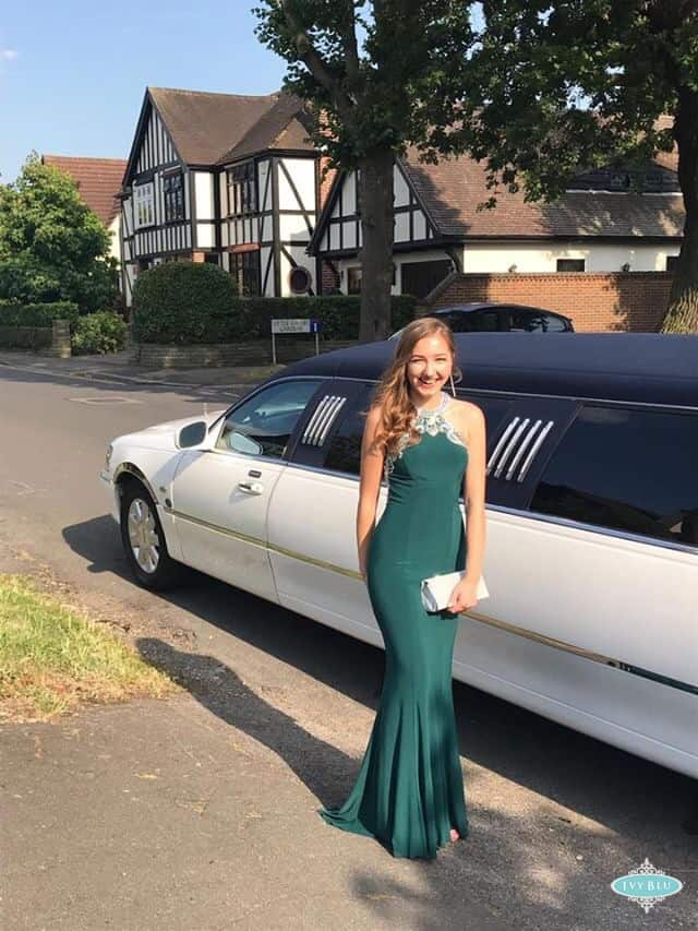 Prom Girl In Green Dress Standing By Limo
