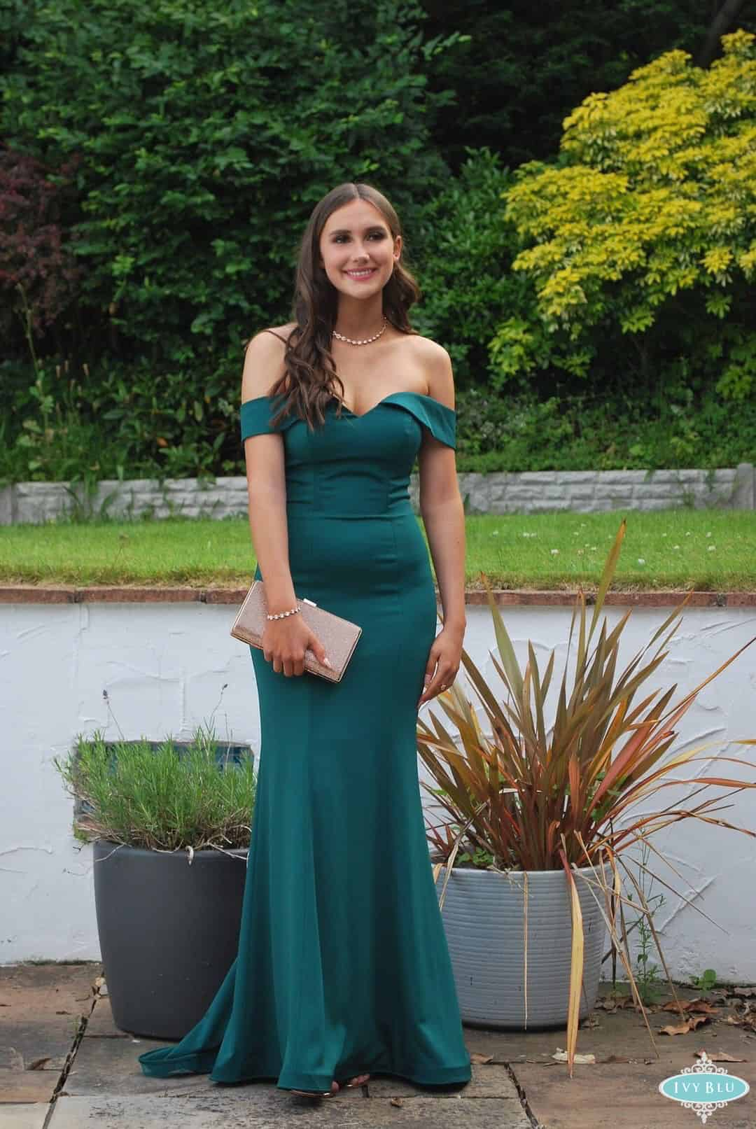 Girl In Full Length Green Off The Shoulder Dress