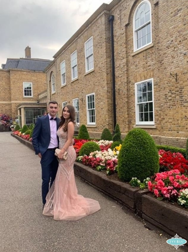 Girl Wearing Rose Dress With Her Prom Date