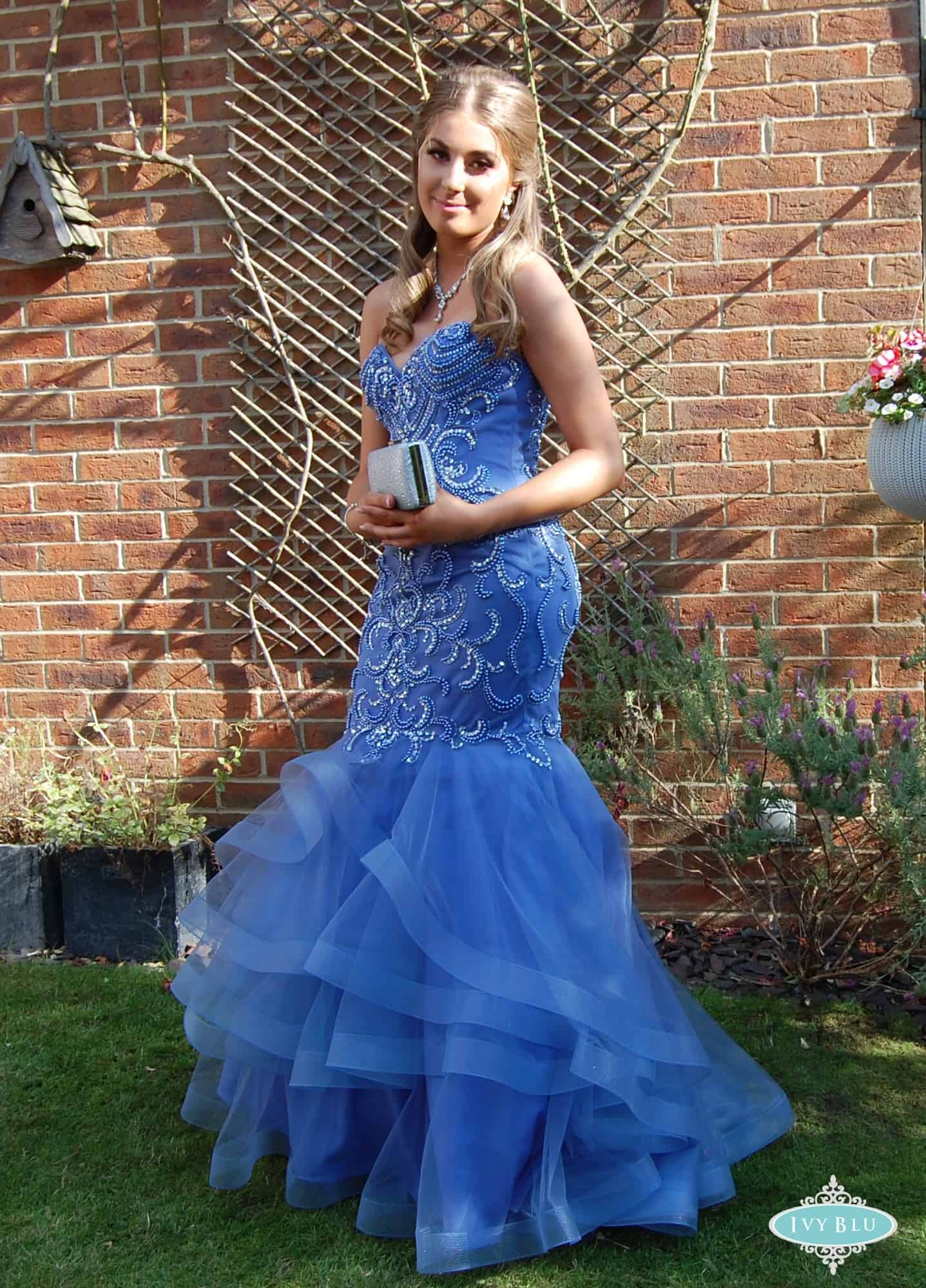 Prom Girl In Blue Dress With Ruffles