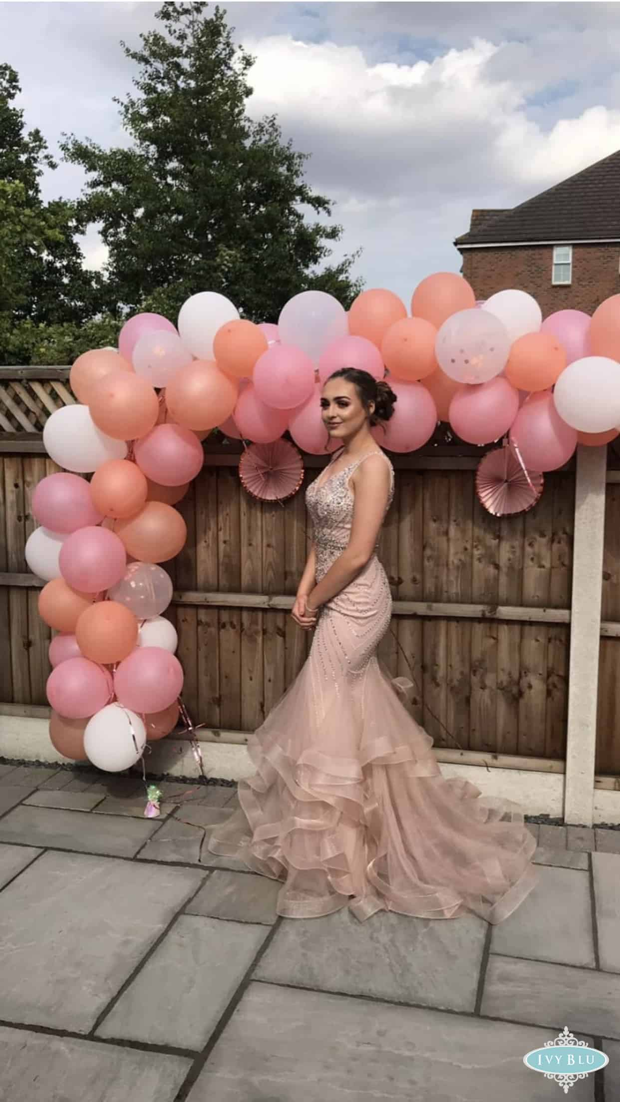 Pron Girl With Full Length Ruffle Dress And Balloons