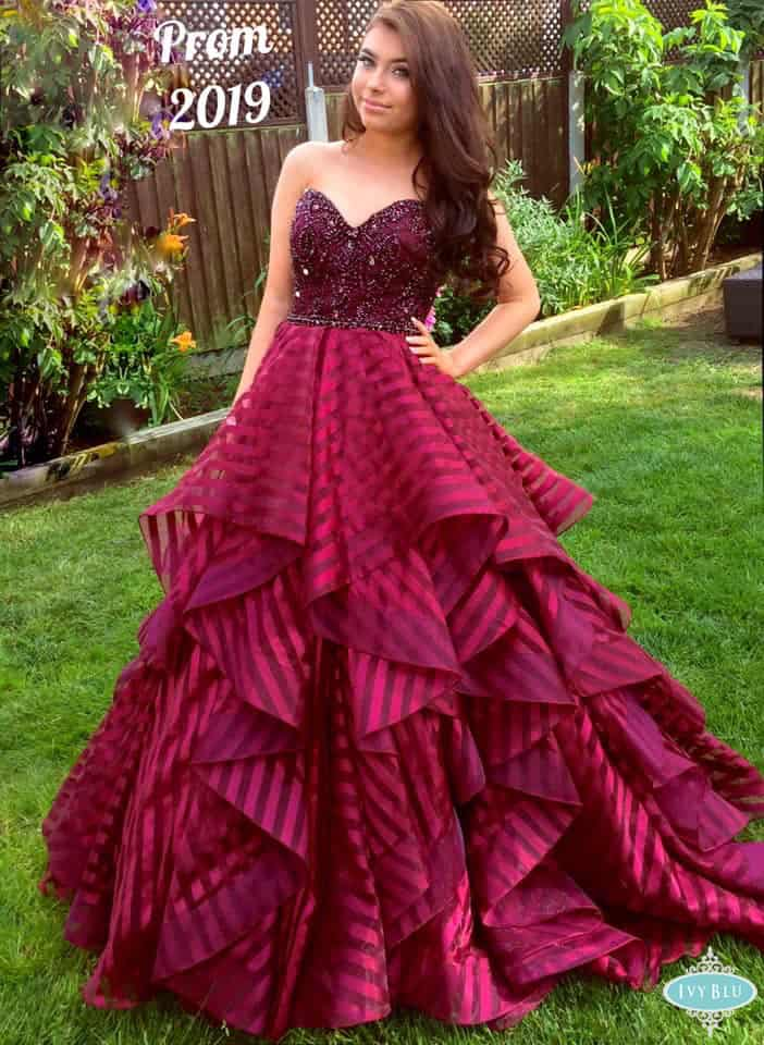 Girl Wearing Wine Colour Ruffled Prom Dress