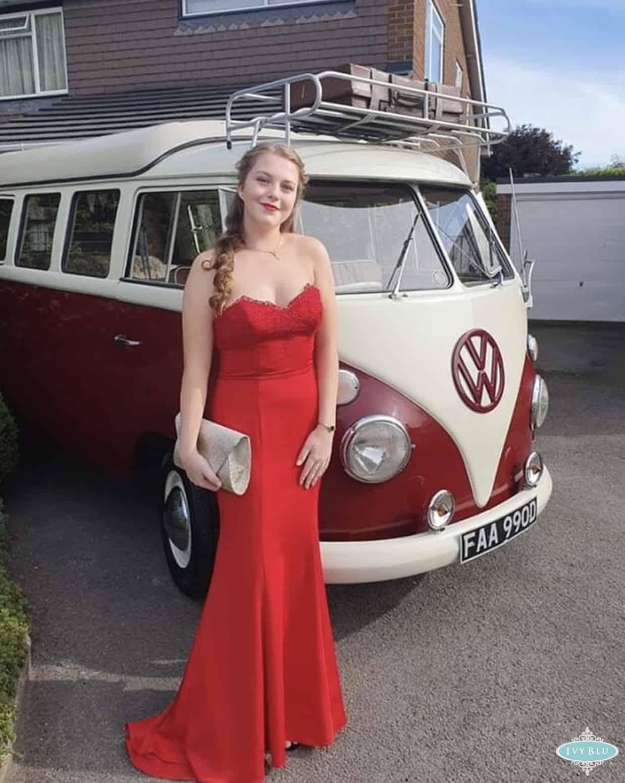 Girl In Long Red Dress Standing By Camper Van