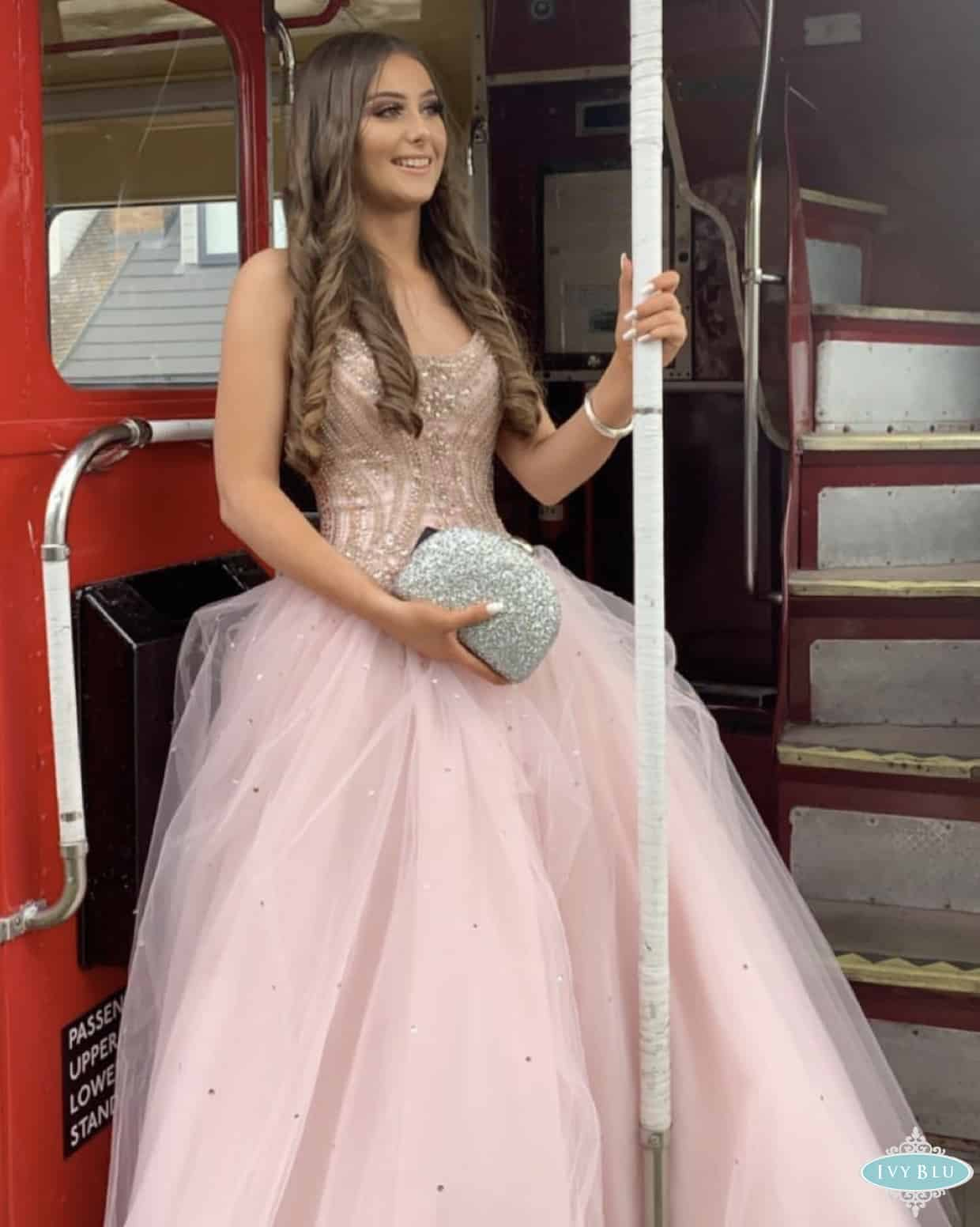 Girl In Pink Princess Dress Standing On Back Of Bus