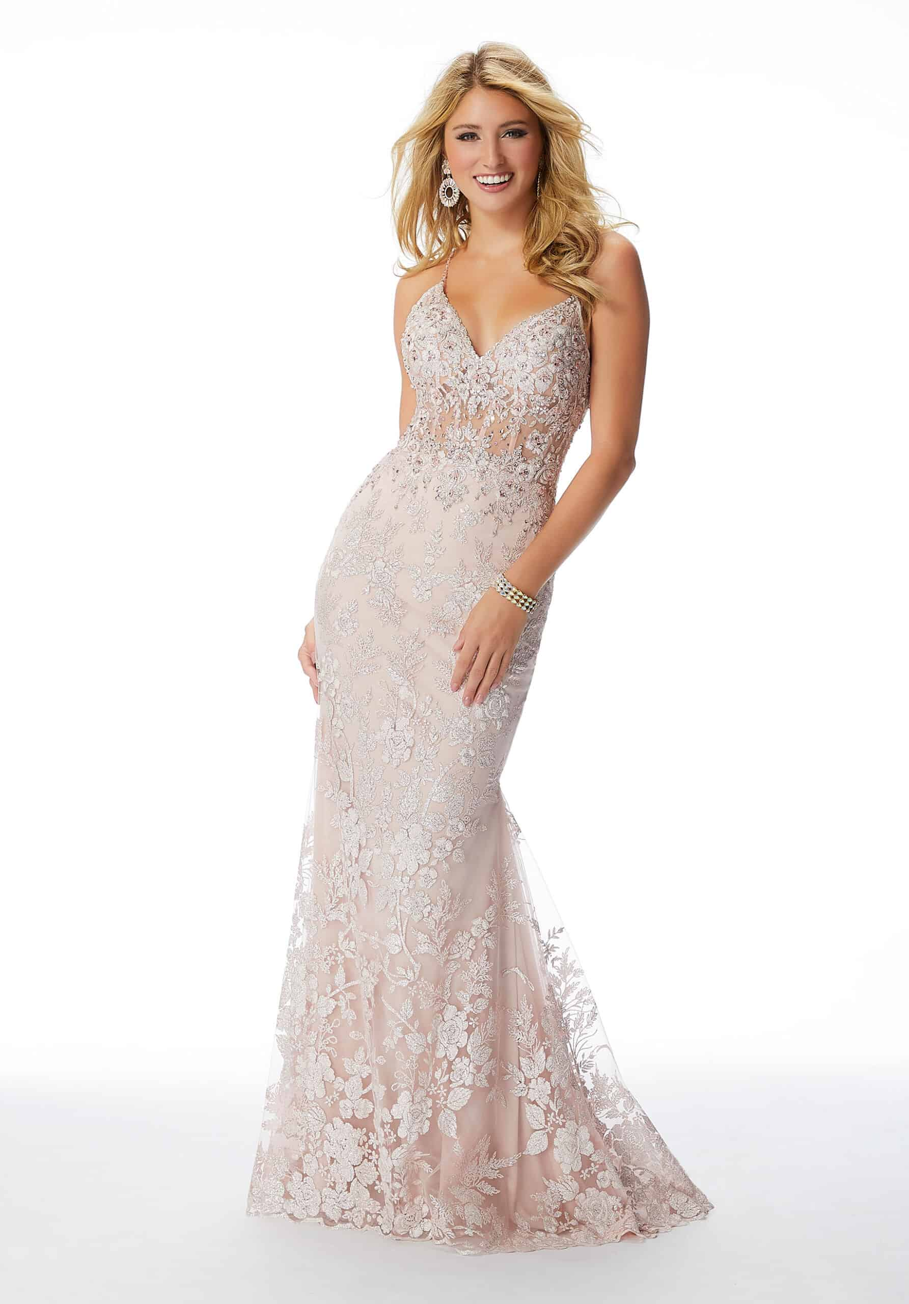 Fitted Prom Gown Featuring A Crystal Beaded Bodice With Exposed Boning, Beaded Crisscross Straps, And Allover Glitter Floral Embroidery.