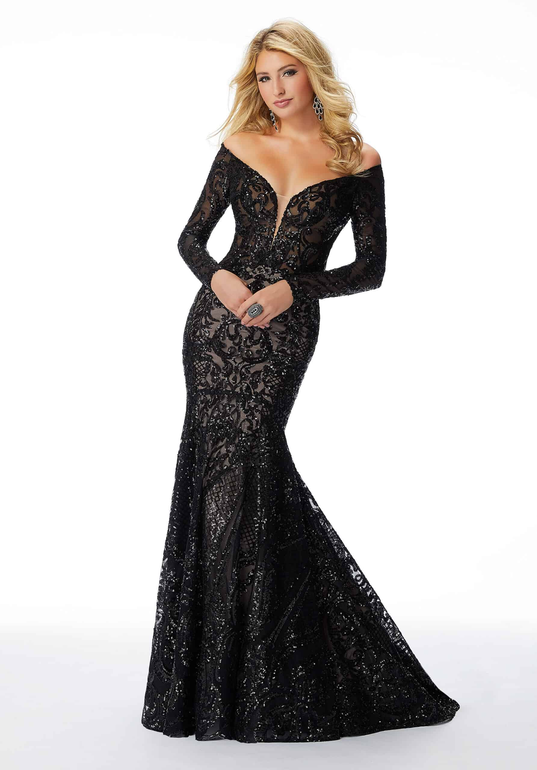 Prom Gown Featuring Off-the-shoulder Long Sleeves, Shimmering Patterned Sequin On Net, And Keyhole Back Detail.